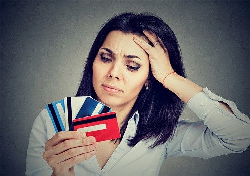 woman overwhelmed by credit card debt