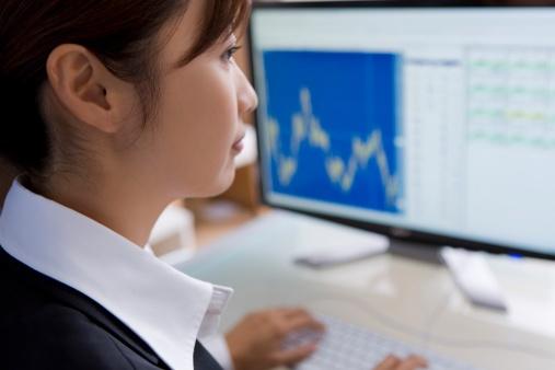 business woman looking at financials