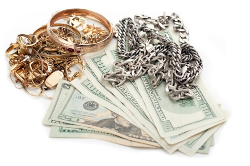 jewelry and cash on table