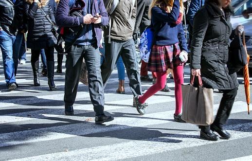 pedestrians crossing street in city