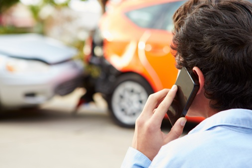 man calling car accident lawyer