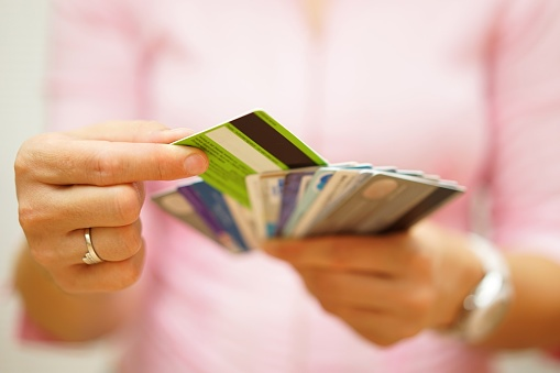 woman_holding_credit_cards