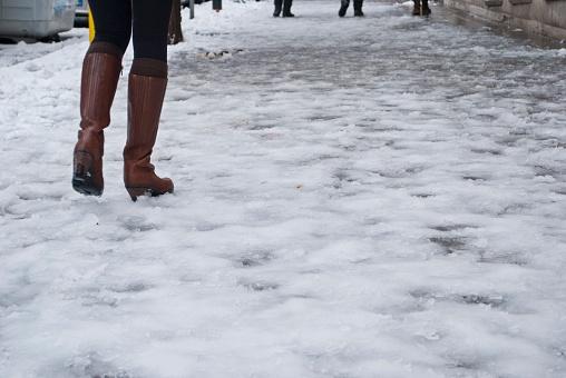 woman walking on icy sidewalk
