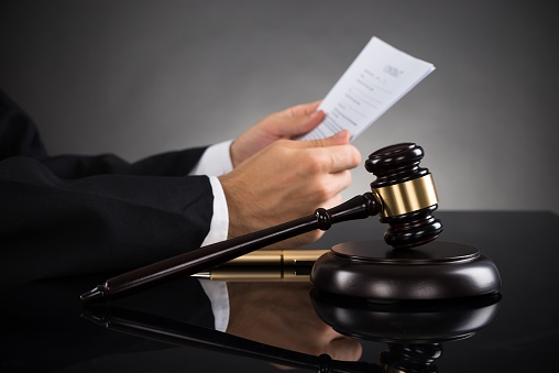 judge holding papers in wrongful death lawsuit
