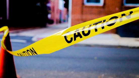 caution tape on city street