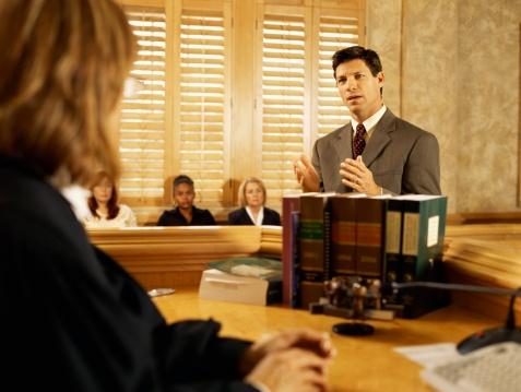 personal injury lawyer talking to judge