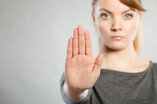 woman with stop hand motion