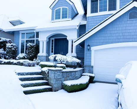 snow covered home after sheriff sale