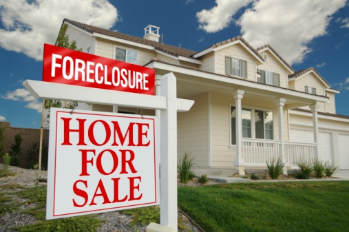 home with foreclosure sign