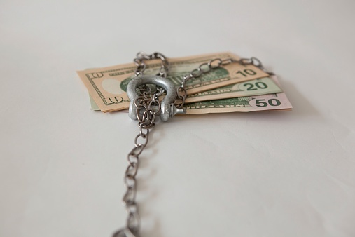 Money tied up in a chain