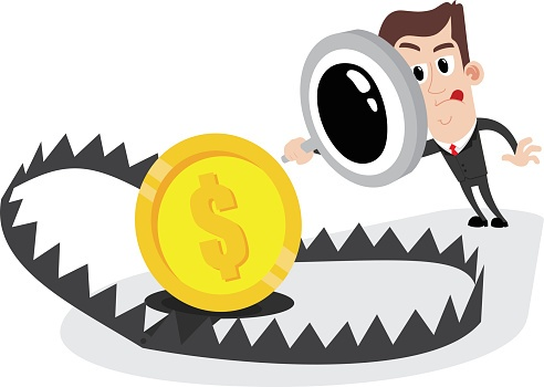 Businessman_with_looking_glass_inspecting_coin_in_beartrap