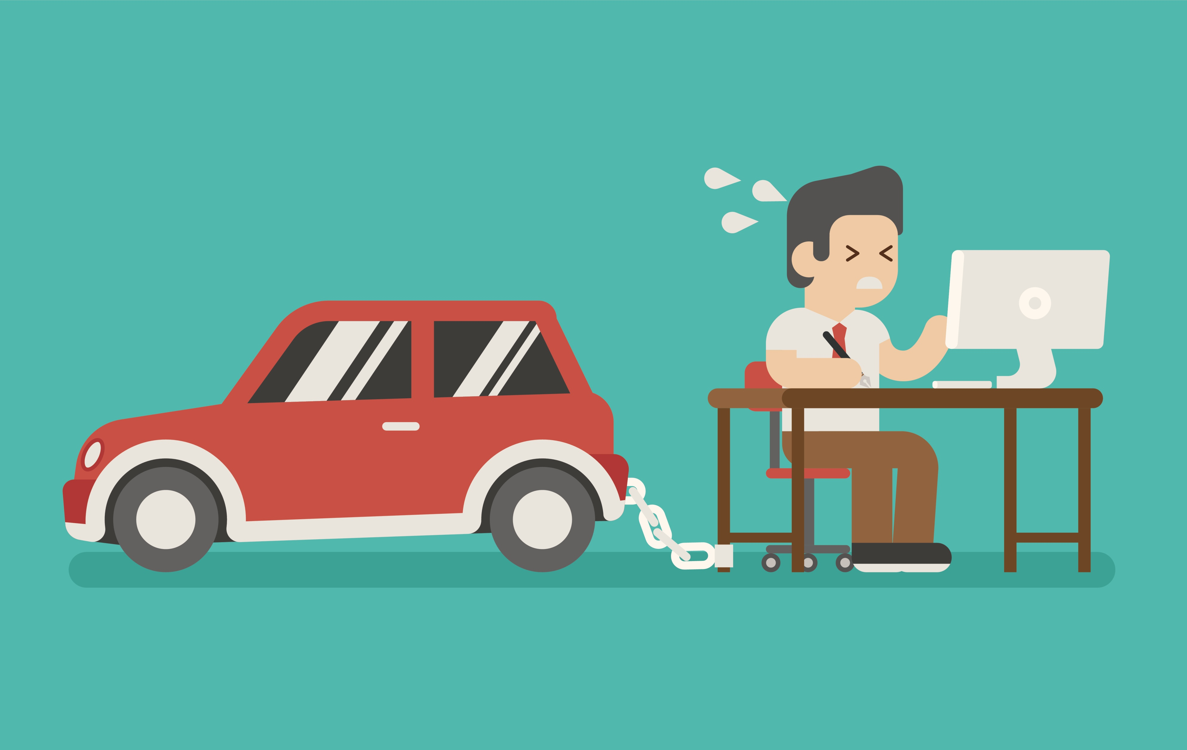 Man at a desk chained to a car