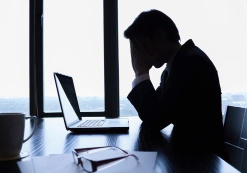 Nervous_businessman_at_desk