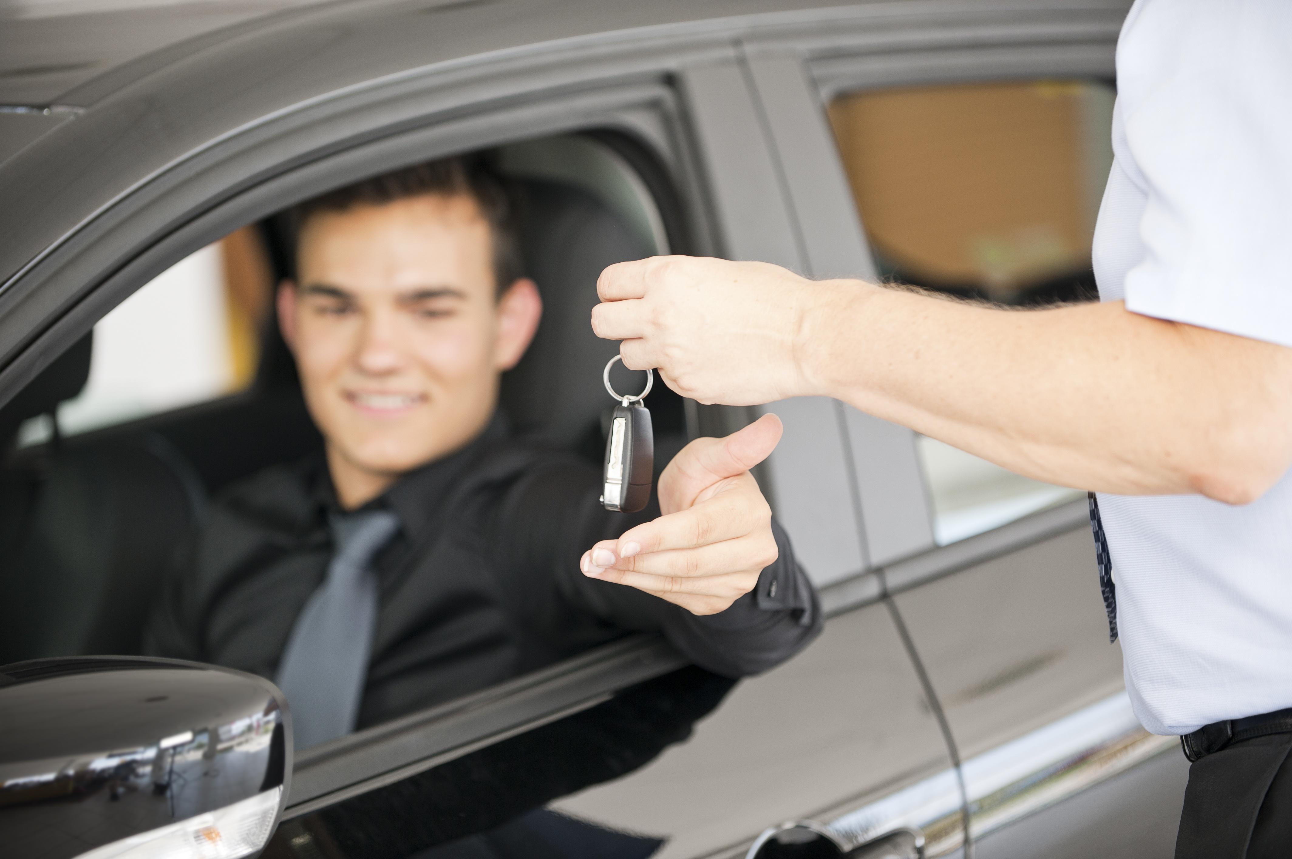 man getting keys to car