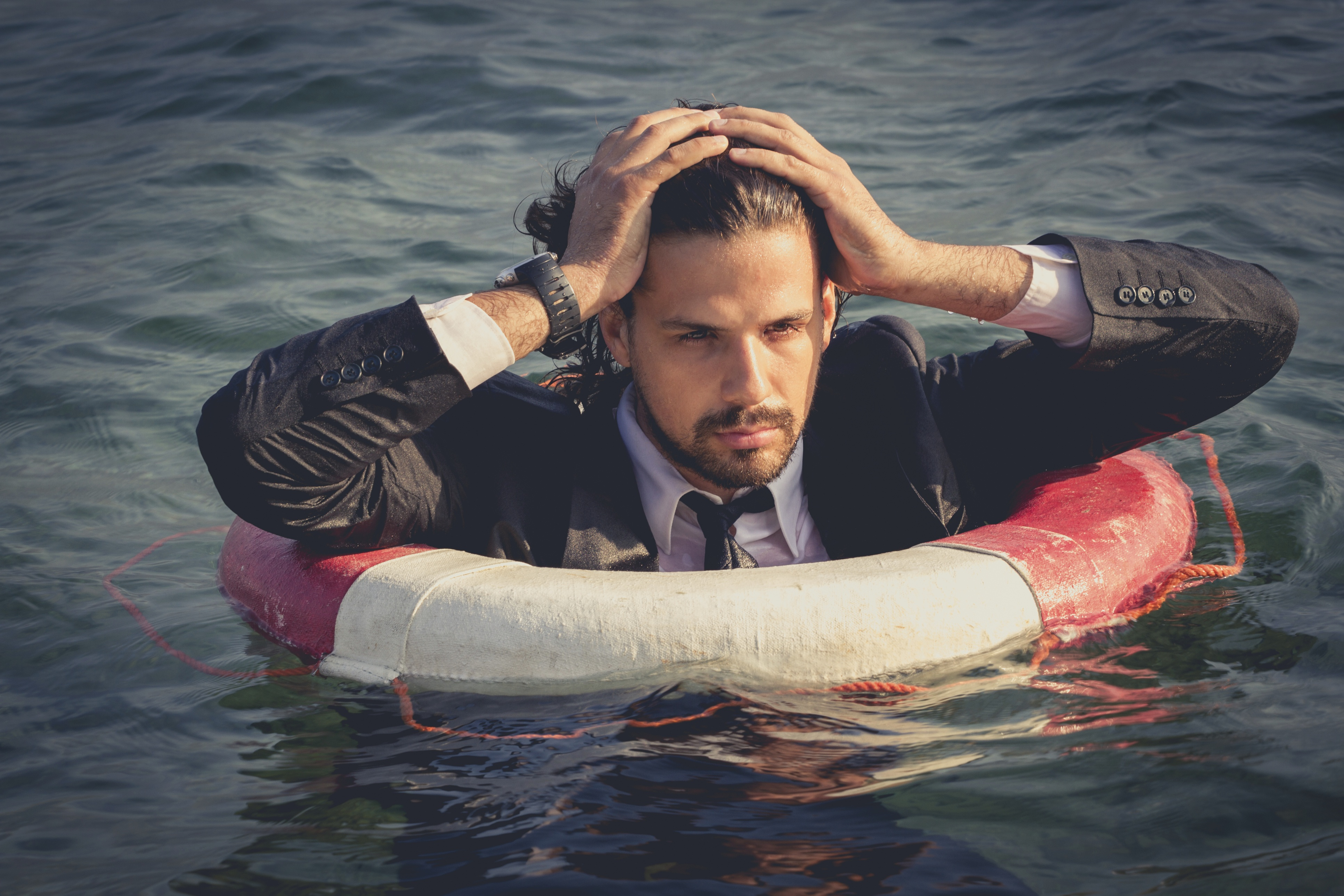 A businessman in a floatation device.