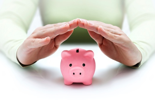 185440401_woman protecting savings in piggy bank.jpg
