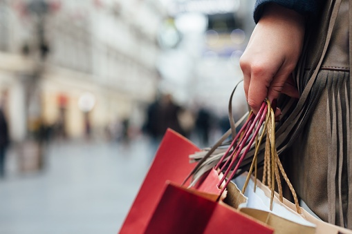 503421060_person_shopping_with_bags.jpg