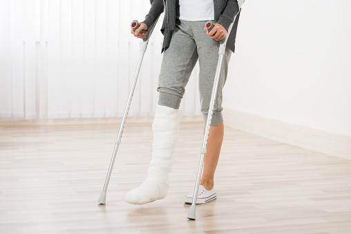 584005312_woman on crutches.jpg