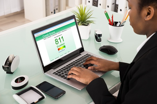 woman checking credit scores