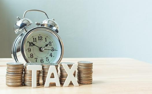 637301242_taxes and clock.jpg