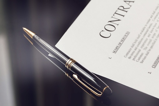 852667530_contract with pen.jpg
