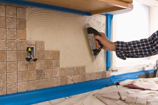 89986642_subcontractor installing tiles.jpg
