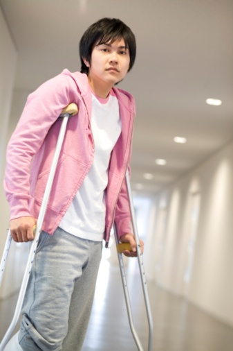 man on crutches in hospital