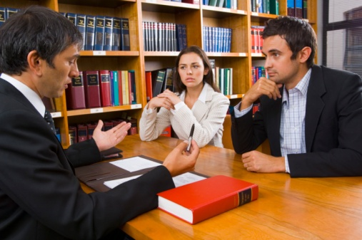 injury lawyer talking with man and woman