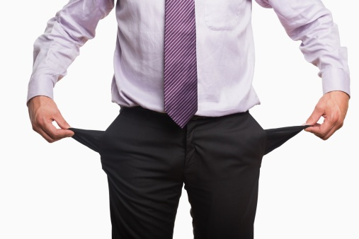 business man with empty pockets ThinkstockPhotos-482232411.jpg