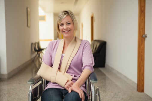 Woman_in_wheelchair_with_cast.jpg